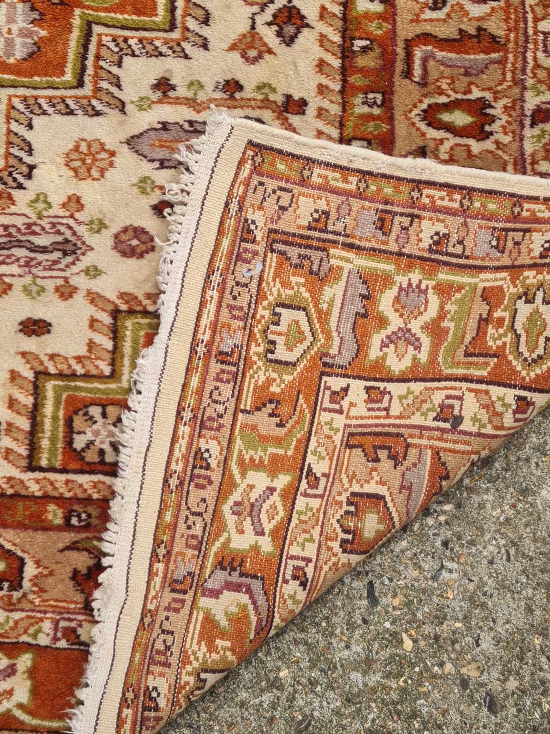 A 20th-century ivory ground Turkish rug with three rust coloured stepped cruciform lozenges within - Image 3 of 4