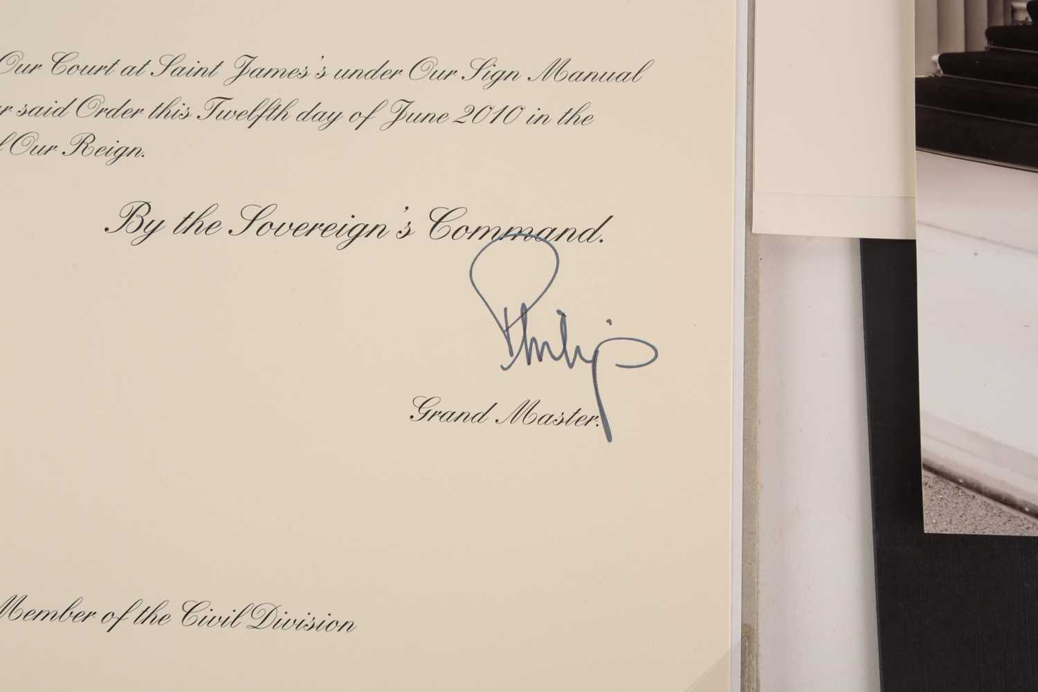 An M.B.E certificate to Keith Leslie Tucker (M.B.E) signed (printed signatures) by her majesty Queen - Image 8 of 10