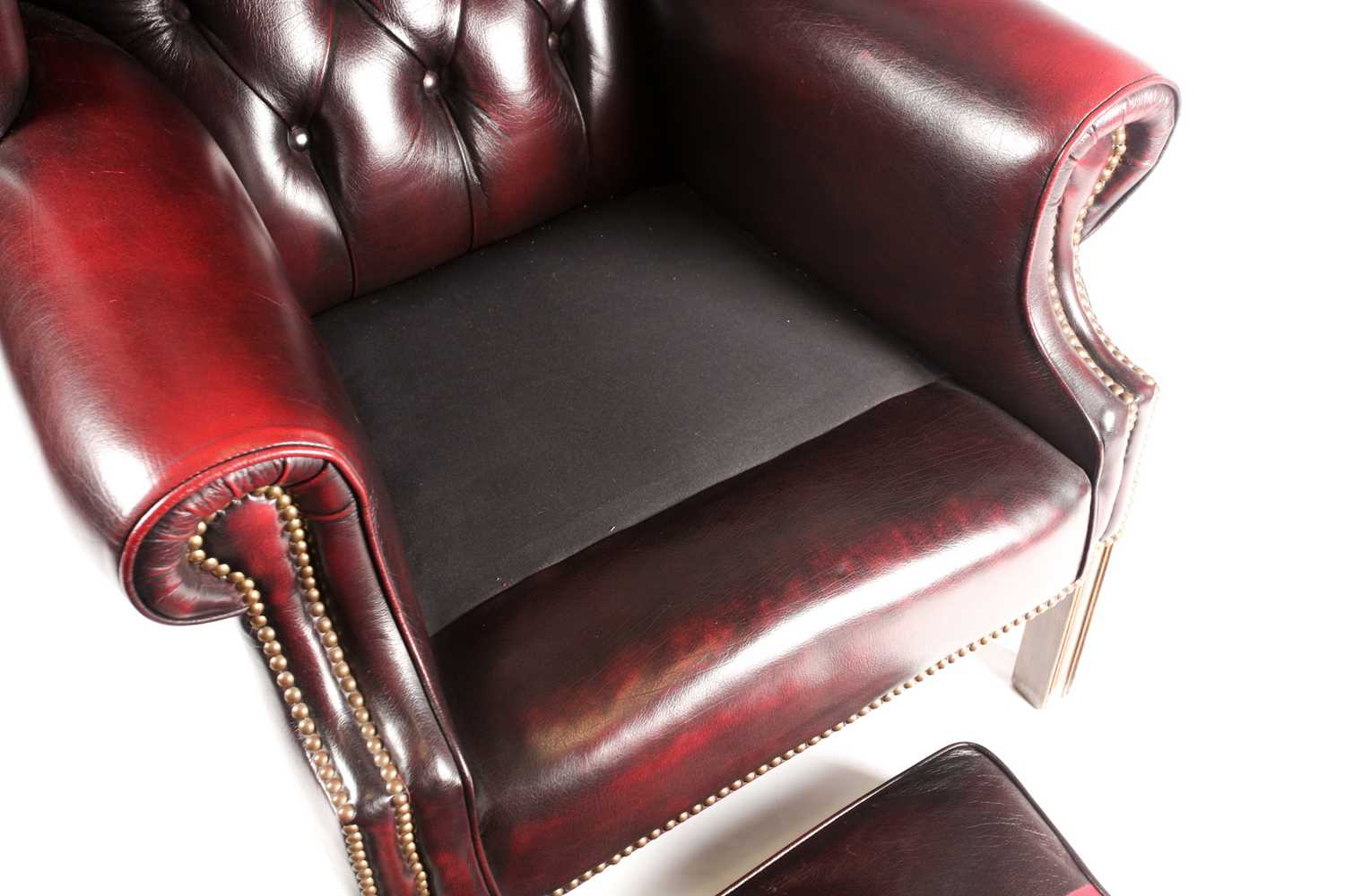 """A George III style deep button """"Ox Blood"""" hide upholstered hipped wing back fireside chair. With - Image 2 of 22"""