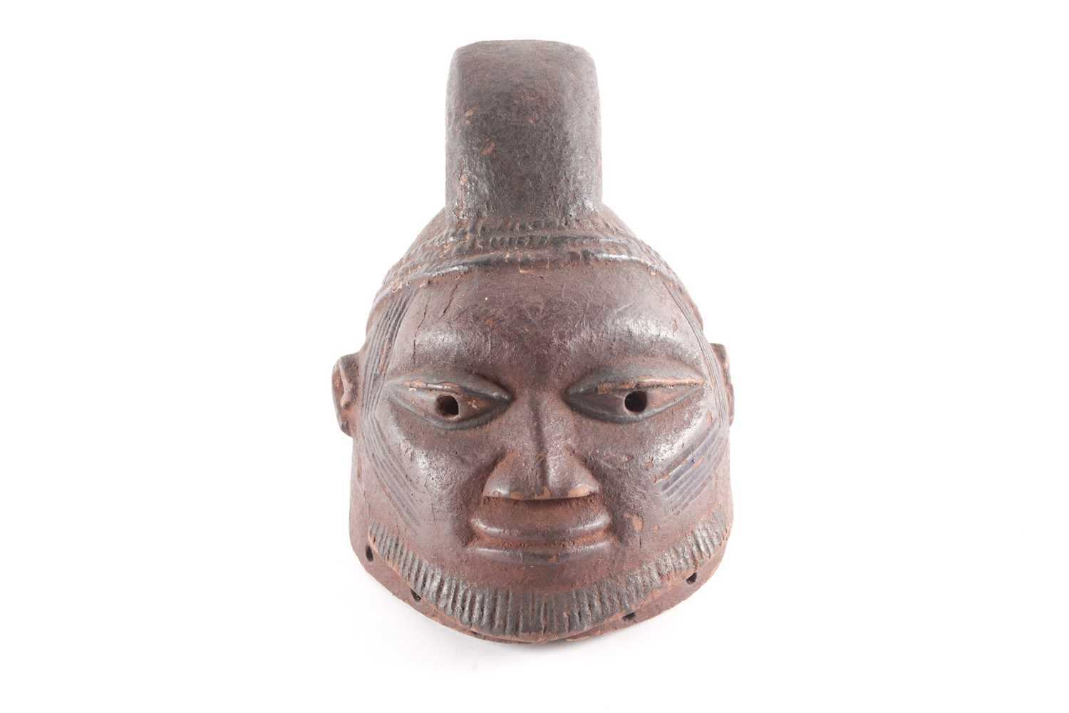 A Yoruba Gelede helmet mask, Nigeria, a crested coiffure above three braided bands, scarifications - Image 2 of 7