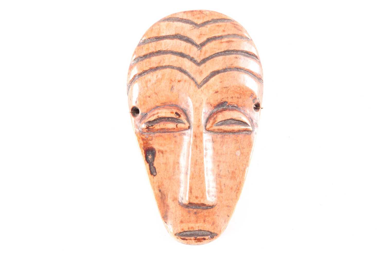 A Lega (Idimu) animal bone Bwami mask, Democratic Republic Congo, the forehead with carved arched