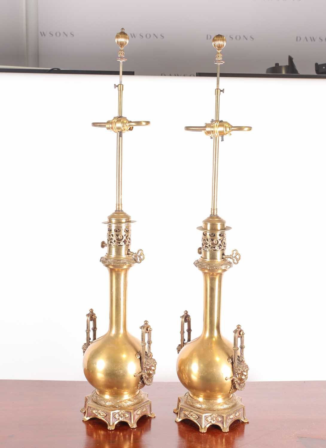 A pair of 19th century French two-handled table lamps (converted for electricity) of bottle form