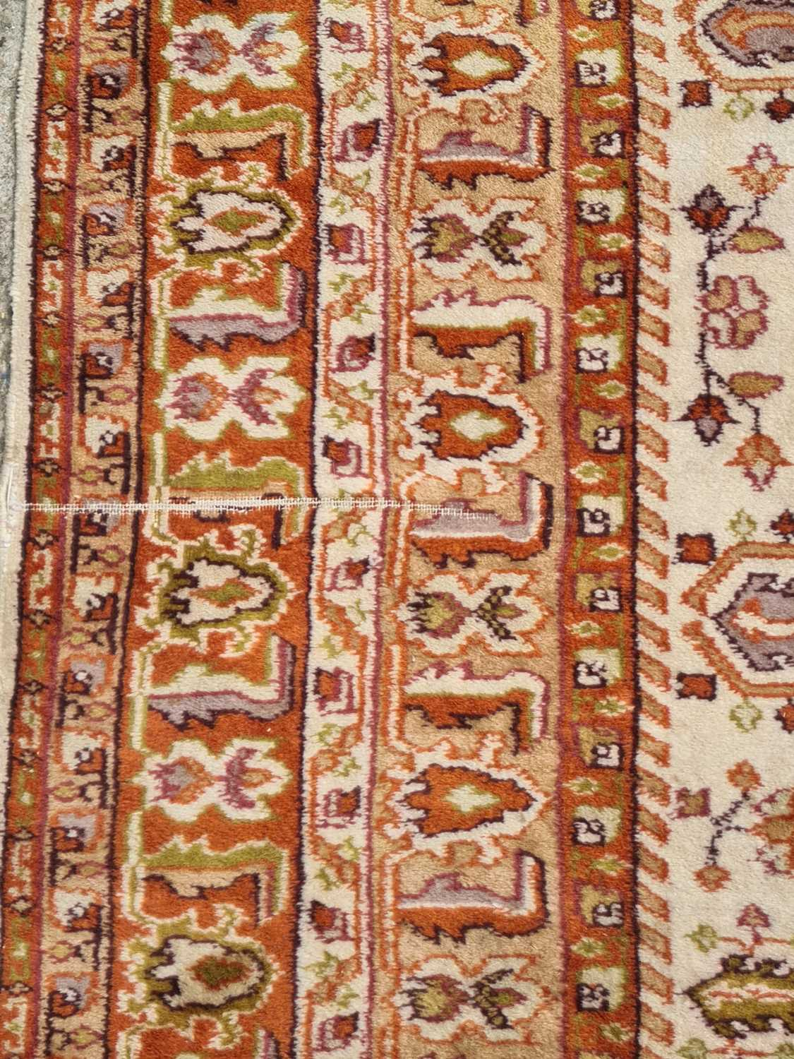 A 20th-century ivory ground Turkish rug with three rust coloured stepped cruciform lozenges within - Image 4 of 4