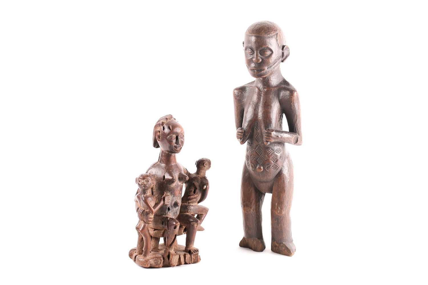 A Baule maternity figure, Ivory Coast, the smiling figure seated upon a stool and holding onto two - Image 4 of 4