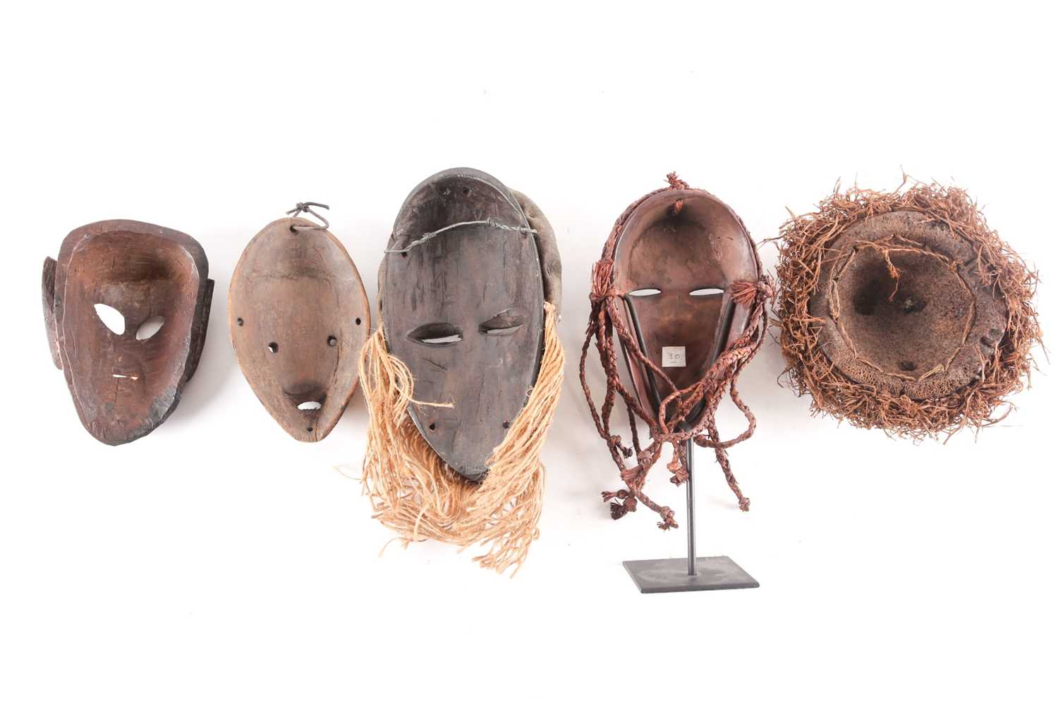 Three Dan passport masks, Ivory coast, one with long woven natural fibres above a median line - Image 2 of 6