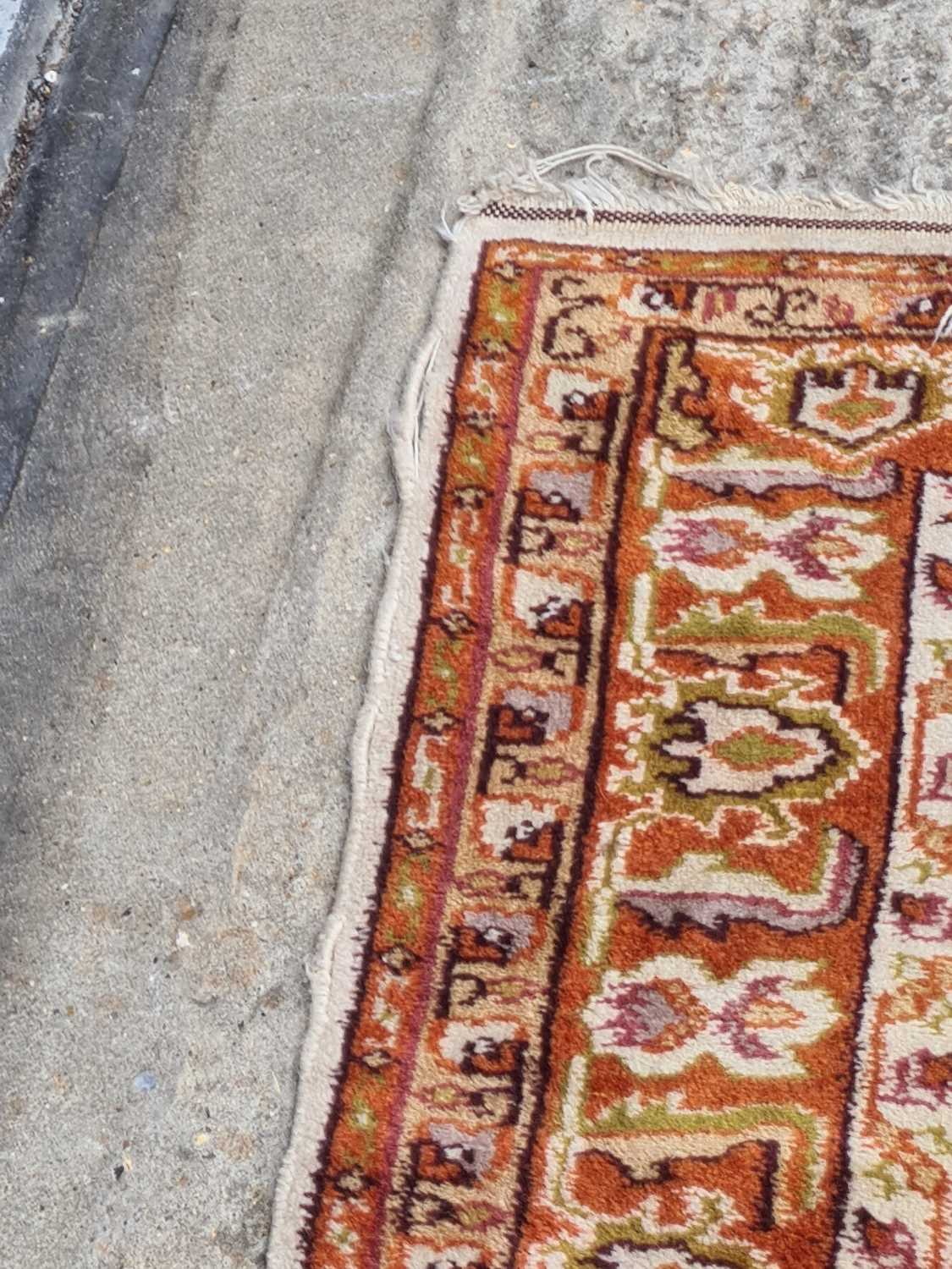 A 20th-century ivory ground Turkish rug with three rust coloured stepped cruciform lozenges within - Image 2 of 4