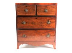 A small George III style satinwood strung mahogany caddy topped chest of drawers. With two short