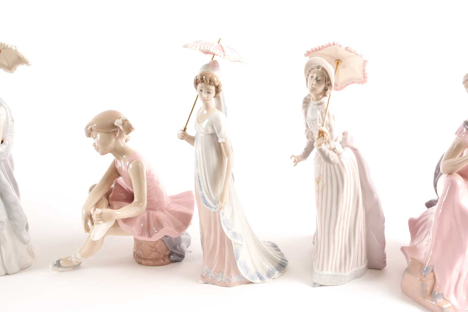 Four Lladro promenading ladies, each with a parasol, and three D'Angila figures, tallest 31. - Image 5 of 10