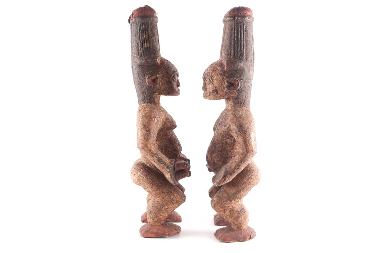 A pair of Ibo spirit figures, Nigeria, each with tall coiffure, signs of scarifications beneath - Image 2 of 5