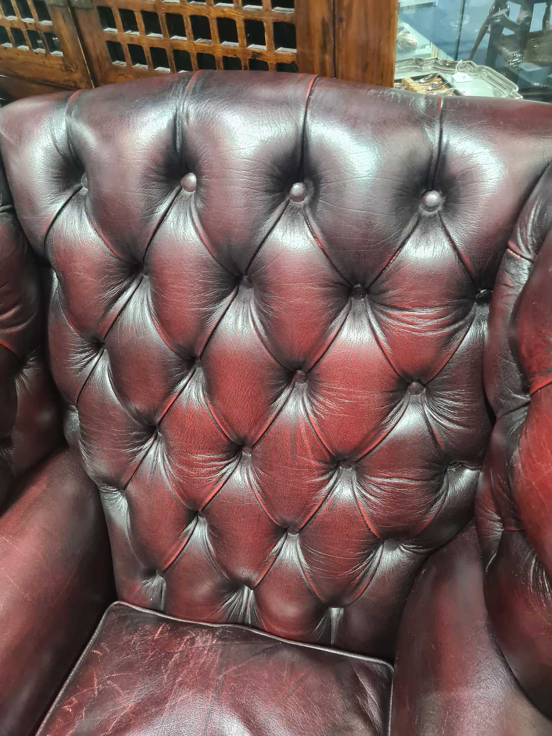 """A George III style deep button """"Ox Blood"""" hide upholstered hipped wing back fireside chair. With - Image 15 of 22"""