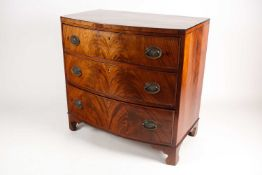 A reconfigured 19th-century mahogany caddy topped bowfront chest of three long drawers. Supported on