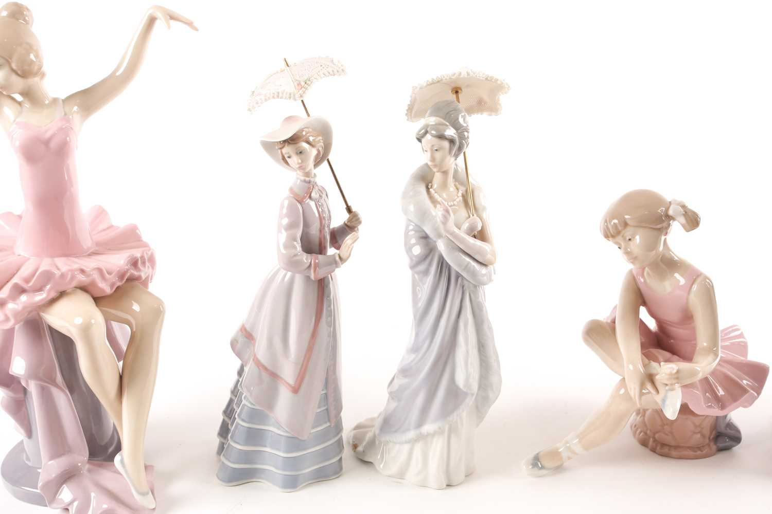 Four Lladro promenading ladies, each with a parasol, and three D'Angila figures, tallest 31. - Image 2 of 10