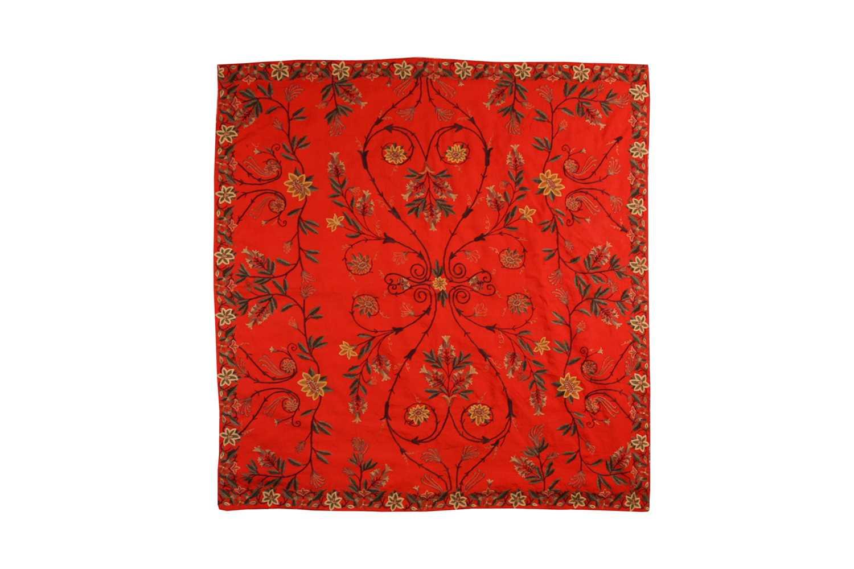 A 20th-century rectangular red ground Kashmiri wall hanging with needlework palmated flowering