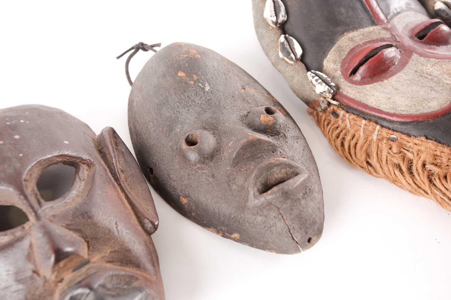 Three Dan passport masks, Ivory coast, one with long woven natural fibres above a median line - Image 3 of 6