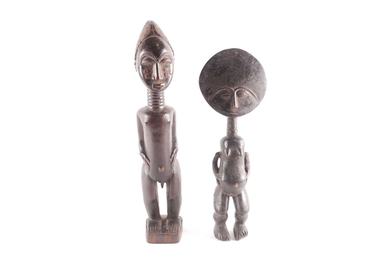 A Baule standing male figure, Blolo Bian, Ivory Coast, the coiffure with linear decoration, the face