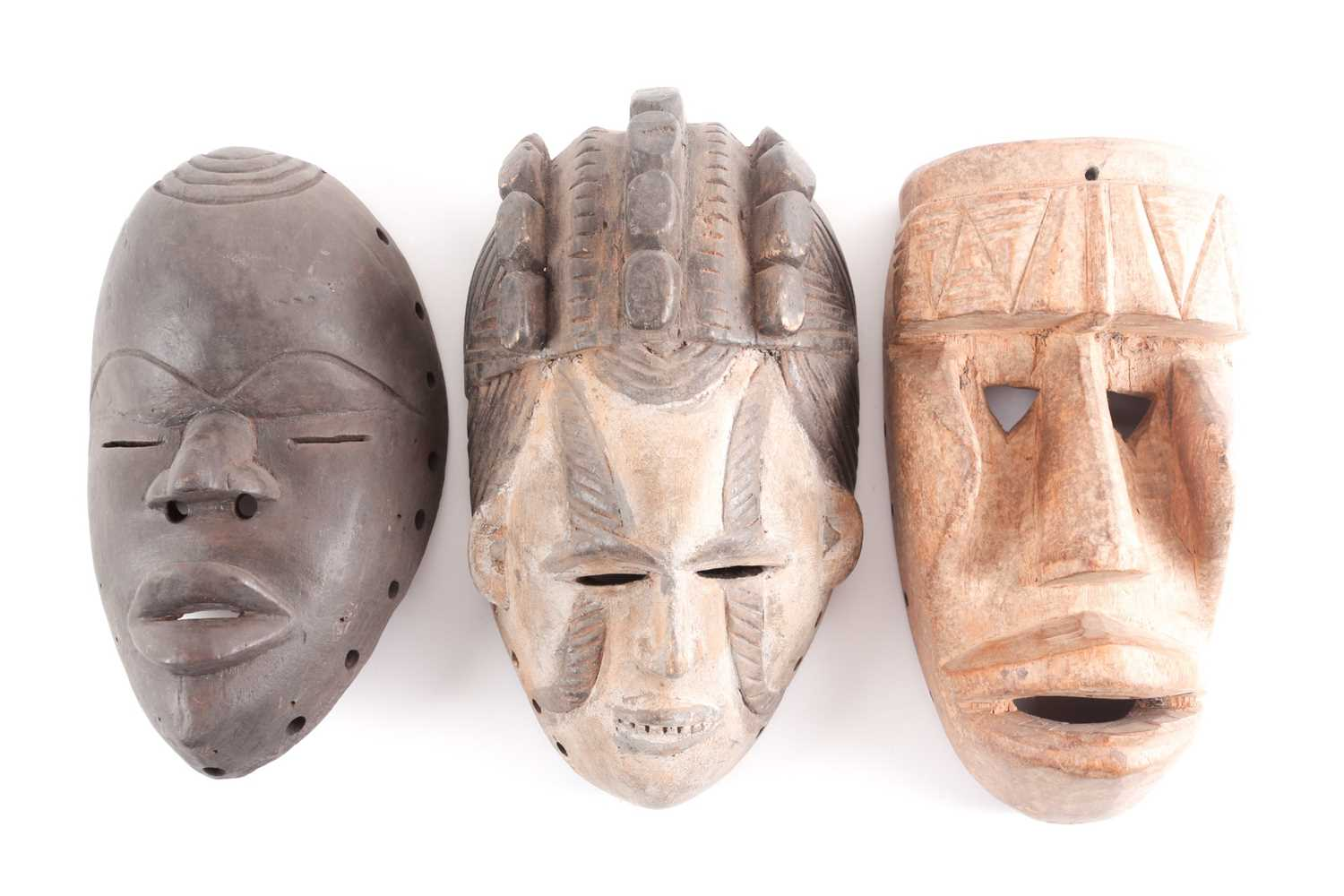 A Guere mask, Ivory Coast, the protruding forehead with geometric carving, above triangular eyes