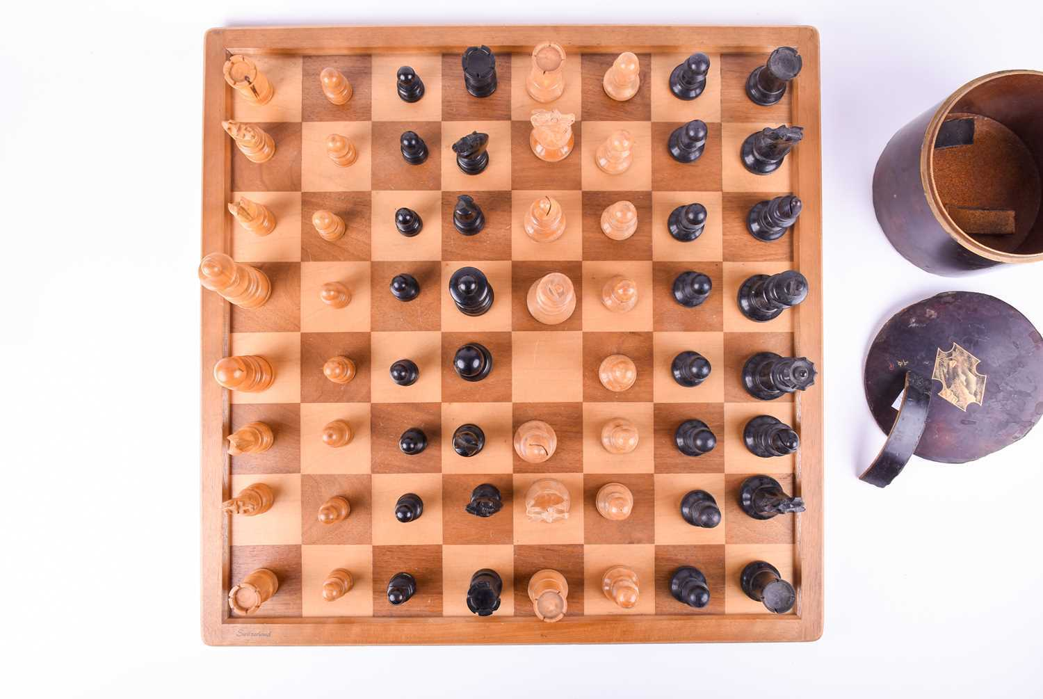 A 19th century turned boxwood and ebony chess set, together with an almost similar 20th century