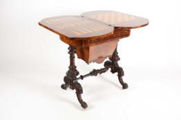 A Victorian marquetry and parquetry inlaid and figured walnut rectangular gaming/ work table