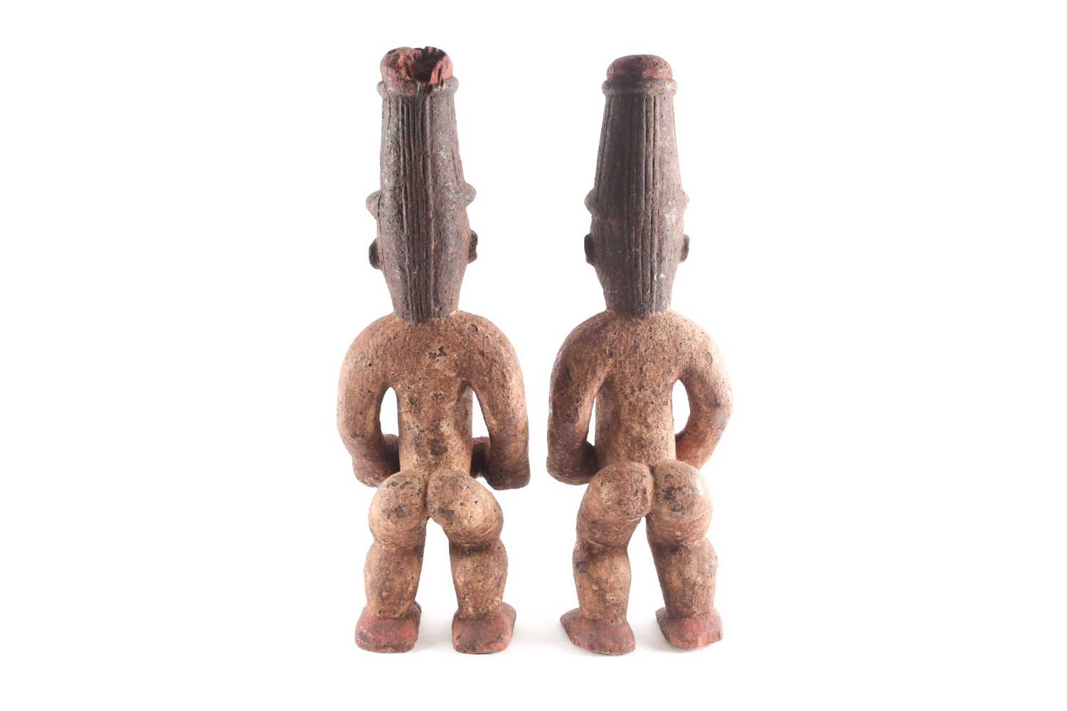 A pair of Ibo spirit figures, Nigeria, each with tall coiffure, signs of scarifications beneath - Image 4 of 5