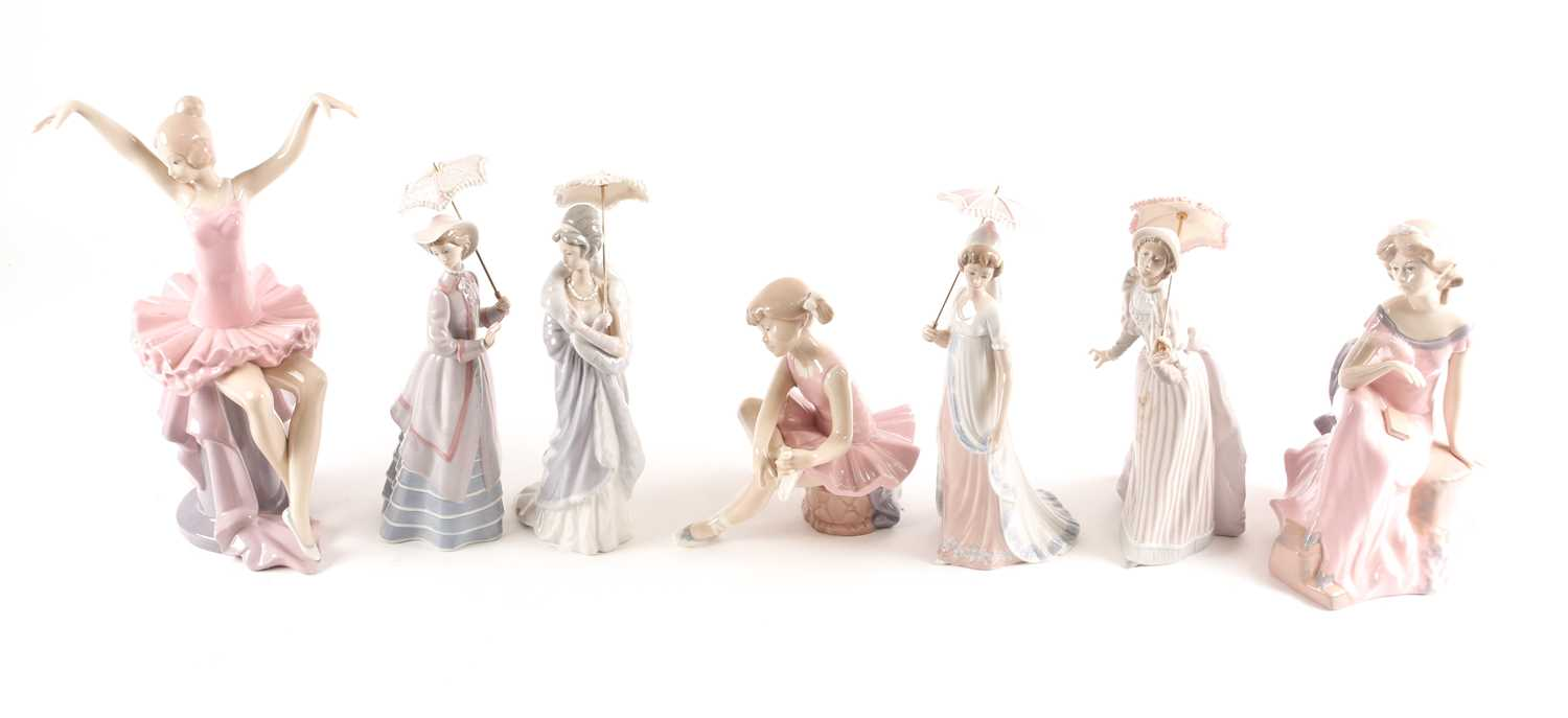Four Lladro promenading ladies, each with a parasol, and three D'Angila figures, tallest 31.