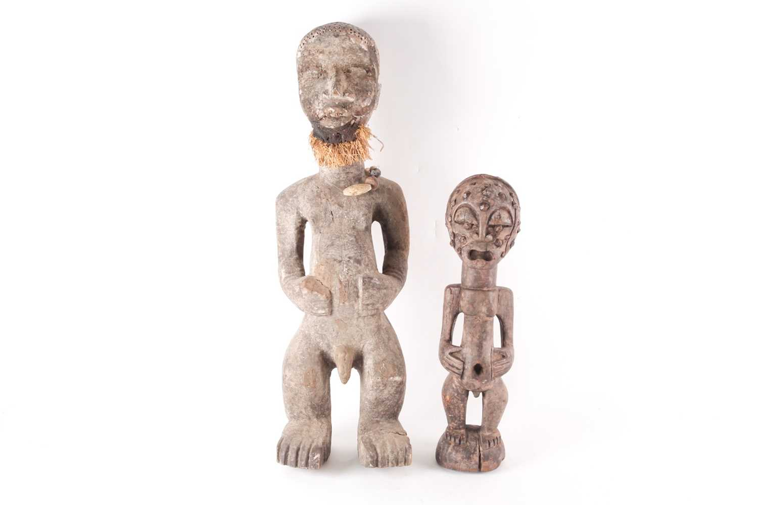 A Songye standing male reliquary power figure, Democratic Republic of Congo, the crown of the head