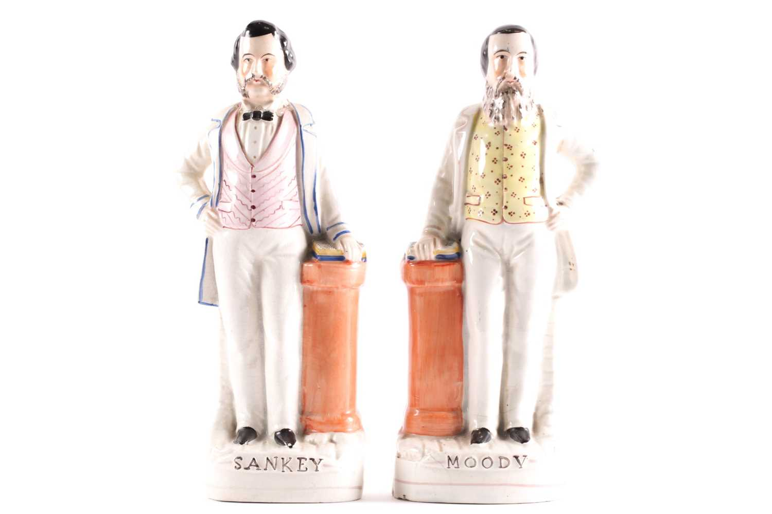 A pair of 19th century Staffordshire figures of American evangelists Dwight Lynam Moody & Ira D