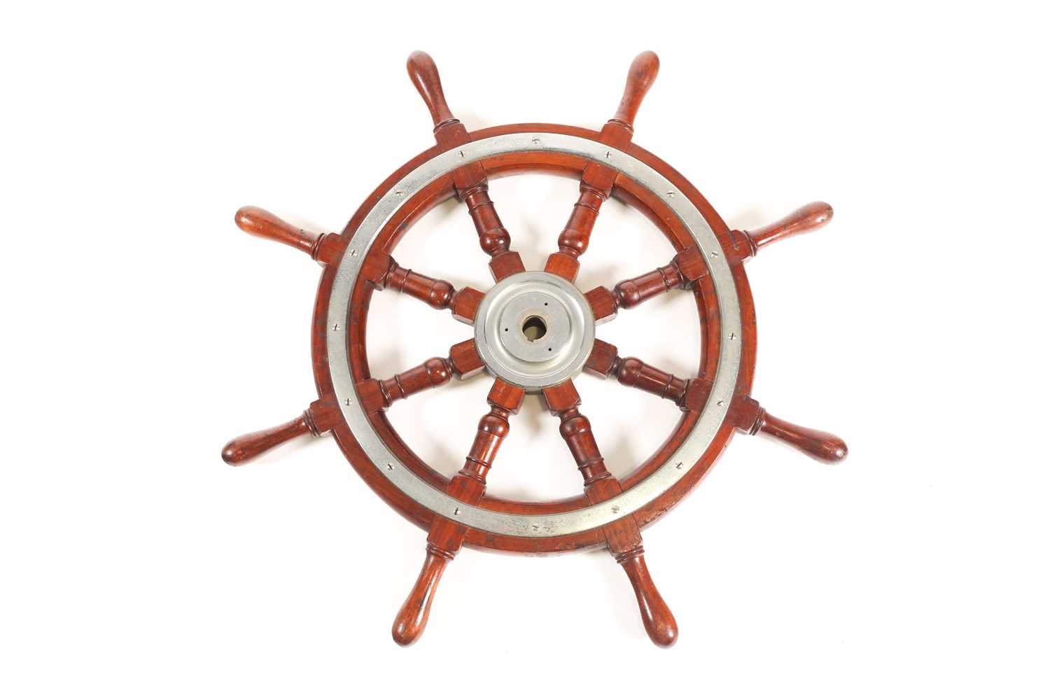 A teak wood ship's wheel with turned spindles and chromium-plated fitments. 77 cm diameter.Condition - Image 2 of 2