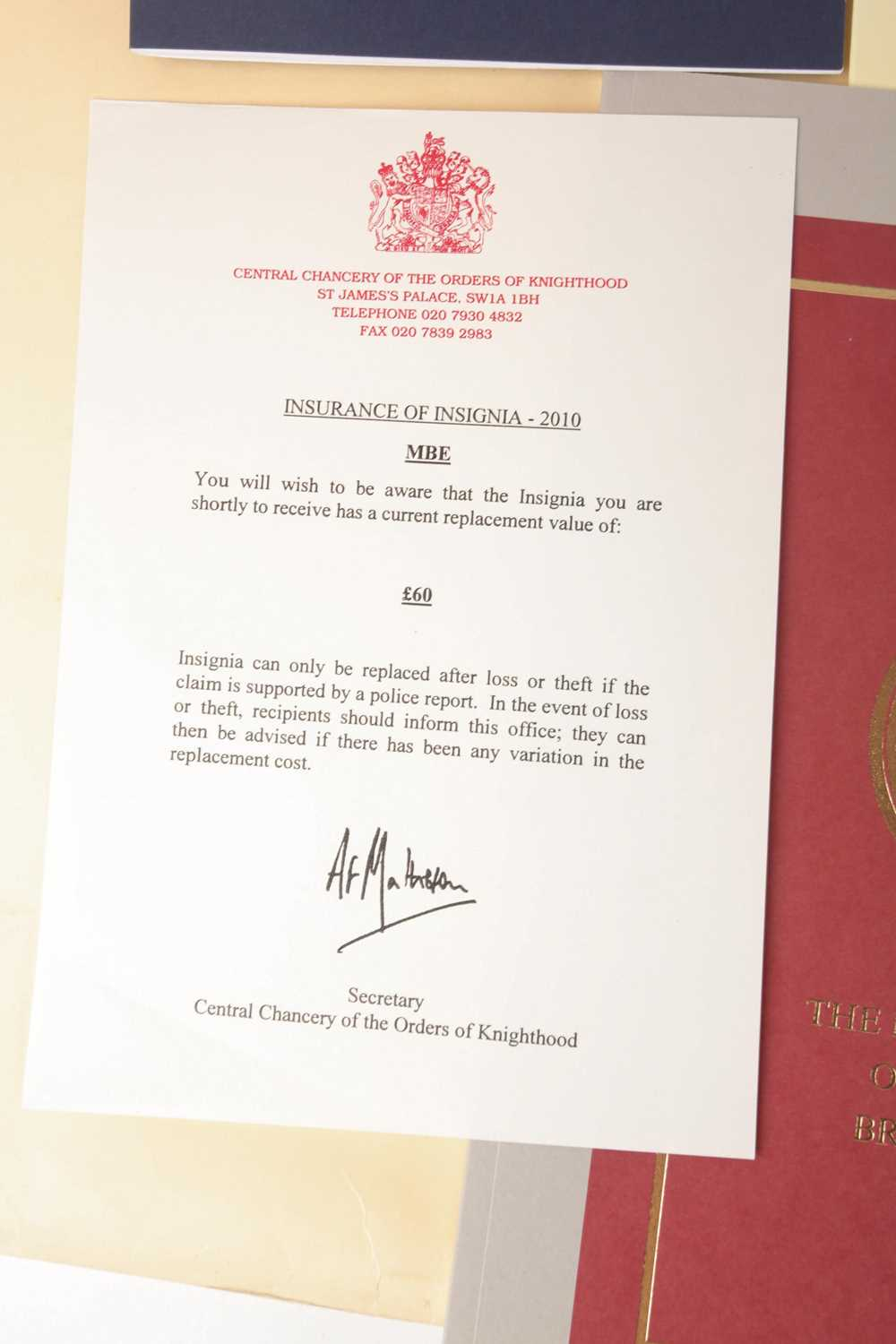An M.B.E certificate to Keith Leslie Tucker (M.B.E) signed (printed signatures) by her majesty Queen - Image 9 of 10