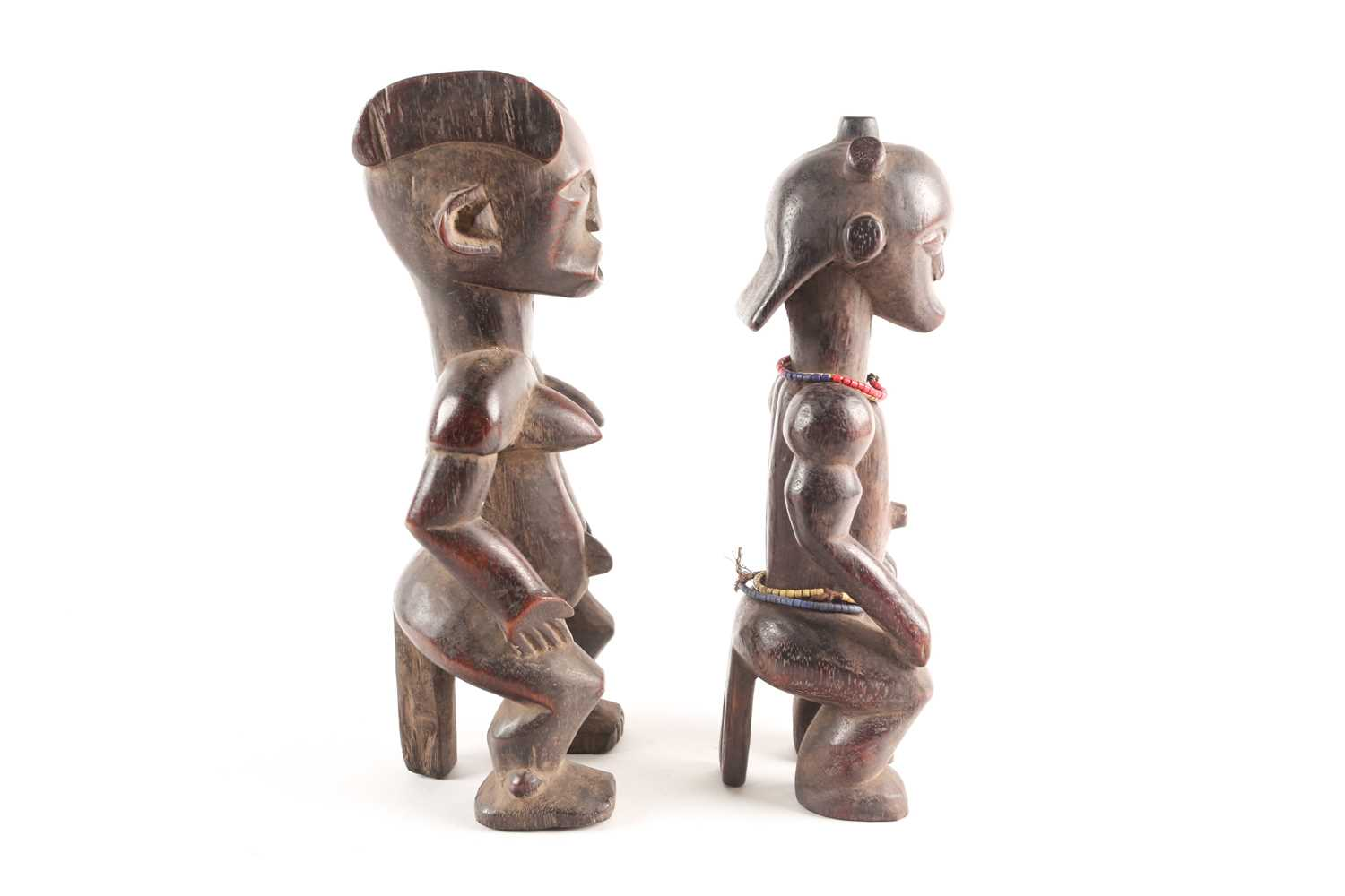 A Fang seated male figure, Gabon, with knotted hair swept out at the rear, seated with his hands - Image 4 of 6