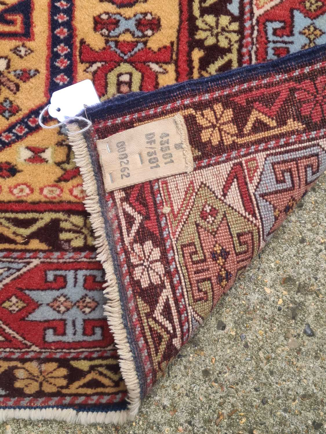 """A 20th-century golden ground Turkish """"Head & Shoulders"""" prayer rug. with stylized tulip motifs - Image 2 of 2"""