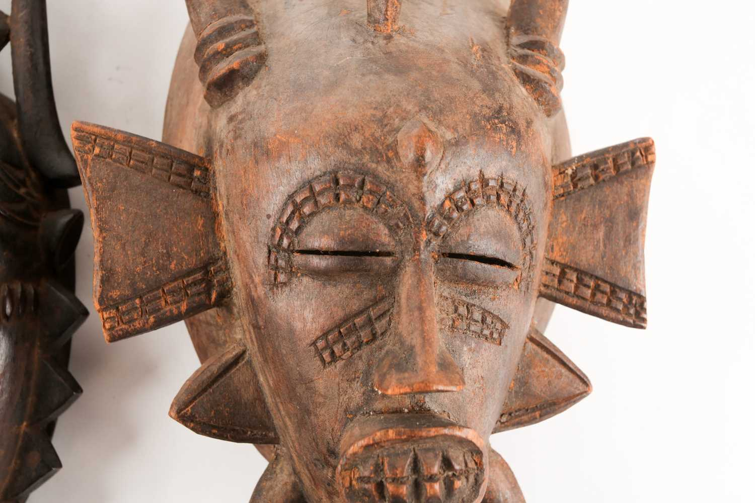 A Senufo Kpelie mask, Ivory Coast, with bird surmount and horns, 34.5cm; and a Yaure mask, Ivory - Image 2 of 4