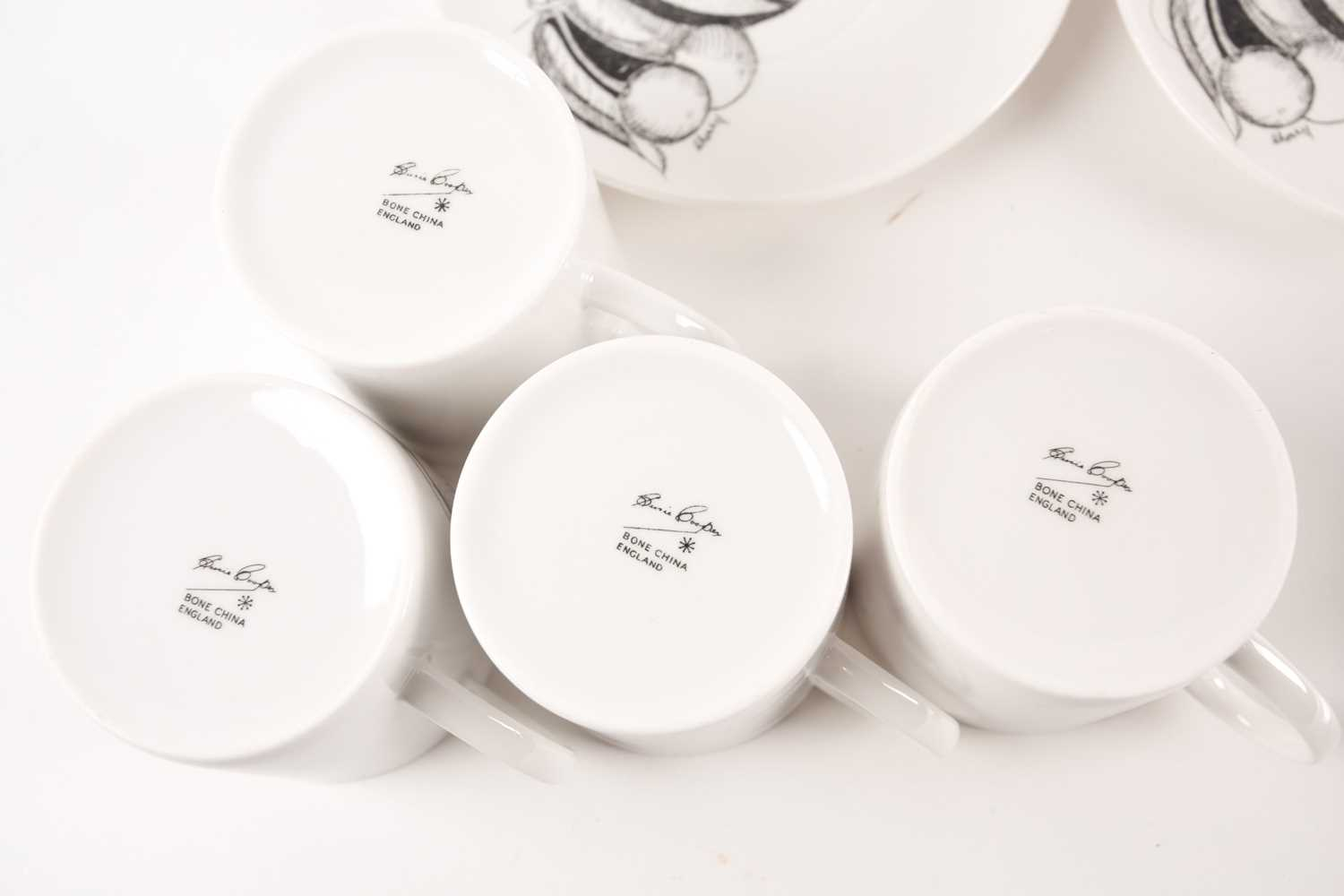 A collection of Susie Cooper black fruit pattern coffee cans and saucers, the cans with variously - Image 2 of 7