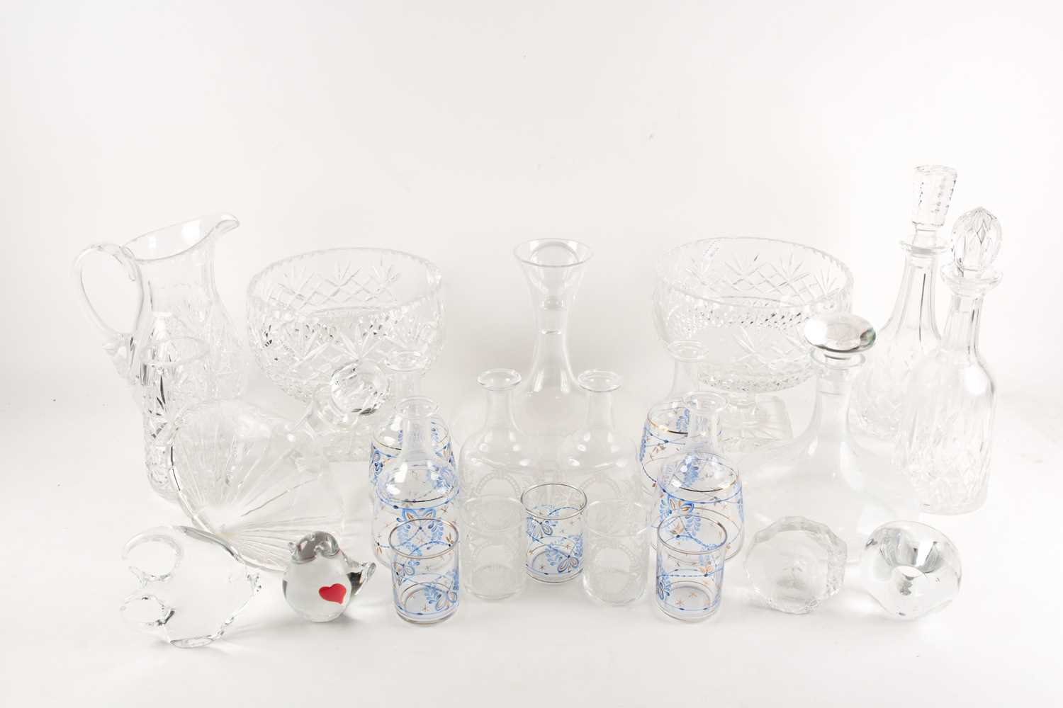 A quantity of cut glass to include a pair of large pedestal bowls, a Waterford decanter, glass