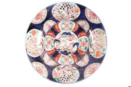 A large Japanese imari dished charger, Edo period, 18th century, painted to the centre with a dragon