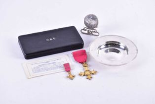 A gilt metal O.B.E. medal on red ribbon together with miniature, in original fitted Royal Mint case,