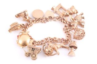 A 9 carat gold charm bracelet, the curb pattern bracelet suspending various charms including the old