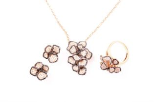 An 18ct rose gold, sapphire and diamond cluster pendant necklace pave set with mixed round-cut