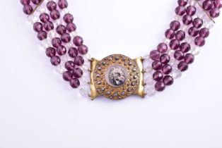 A 19th century gilt cut steel and faceted bead necklace, the central segment depicting a snarling