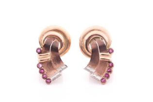 A pair of vintage tri-coloured yellow metal and ruby ear clips; in the form of a stylised knot, each