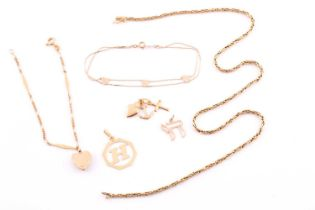 A gold foxtail link chain; marked '750'; 14.2 grams; two further chains and several charms.