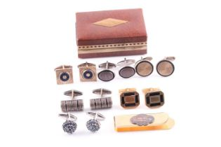A pair of 14ct yellow gold and black enamel cufflinks, together with five further pairs of white