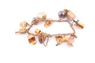 A charm bracelet; the 9 carat gold curb pattern bracelet with padlock clasp; suspending 13 various