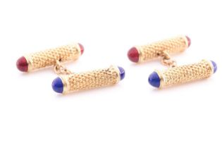 A pair of yellow metal textured baton cufflinks, with blue and red enamel terminals, indistinct