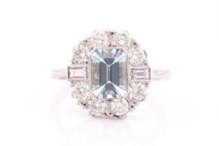 A platinum, diamond, and aquamarine ring, set with an emerald-cut aquamarine of approximately 1.20