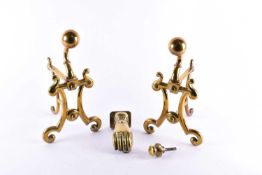 A pair of Art Nouveau style brass andirons, circa 1900, together with a brass door knocker, formed