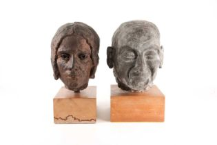 A stoneware bust of a elderly lady, her hair in a bun, in a bronzed finish, and a bust of an elderly