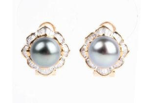 A pair of Tahitian grey pearl and baguette diamond cluster earrings, the central pearls within a