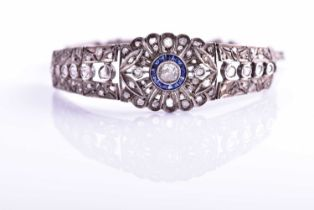 An early 20th century diamond and sapphire bracelet, the articulated mount centred with an old-cut