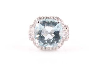 A diamond and aquamarine cocktail ring, set with a cushion-cut aquamarine of approximately 9.90