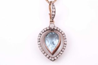 A late 19th / early 20th century diamond and aquamarine pendant, the tapered frame mount inset